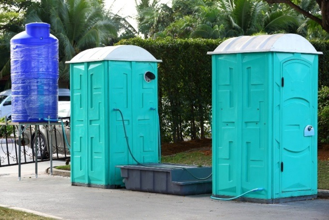 Portable toilet waste disposal